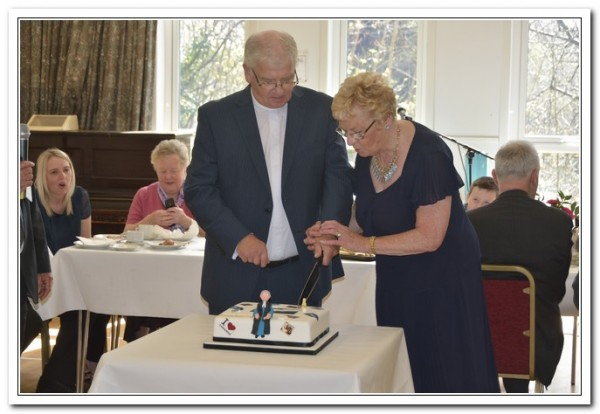 Douglas & his wife Janette cut the Cake