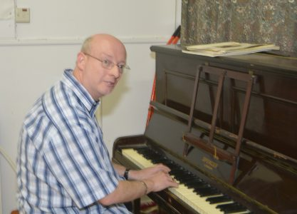 George Hughes at the Piano