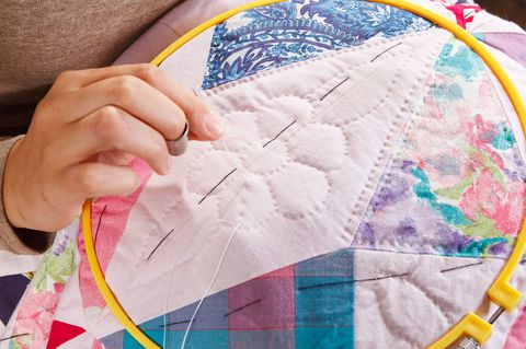 hand sewing a quilt