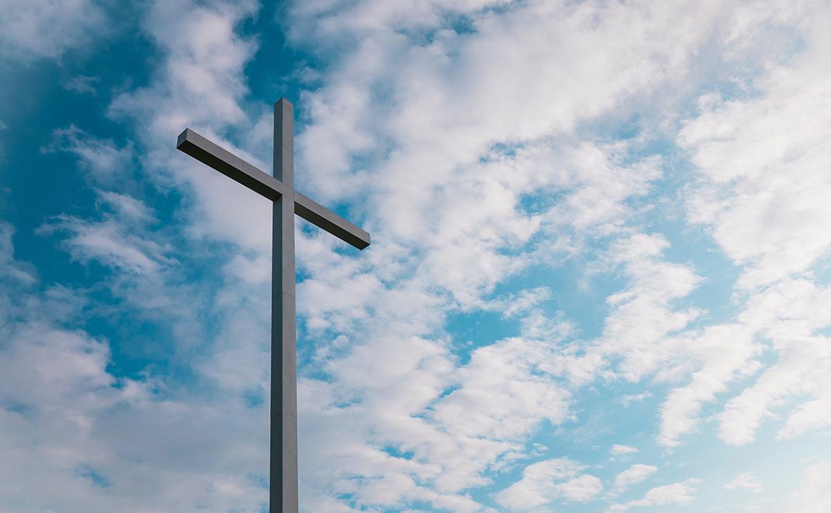 Cross against sky background